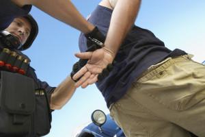 policeman arresting criminal